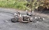 PHOTOS: Motorcycle bursts into flames after collision with car